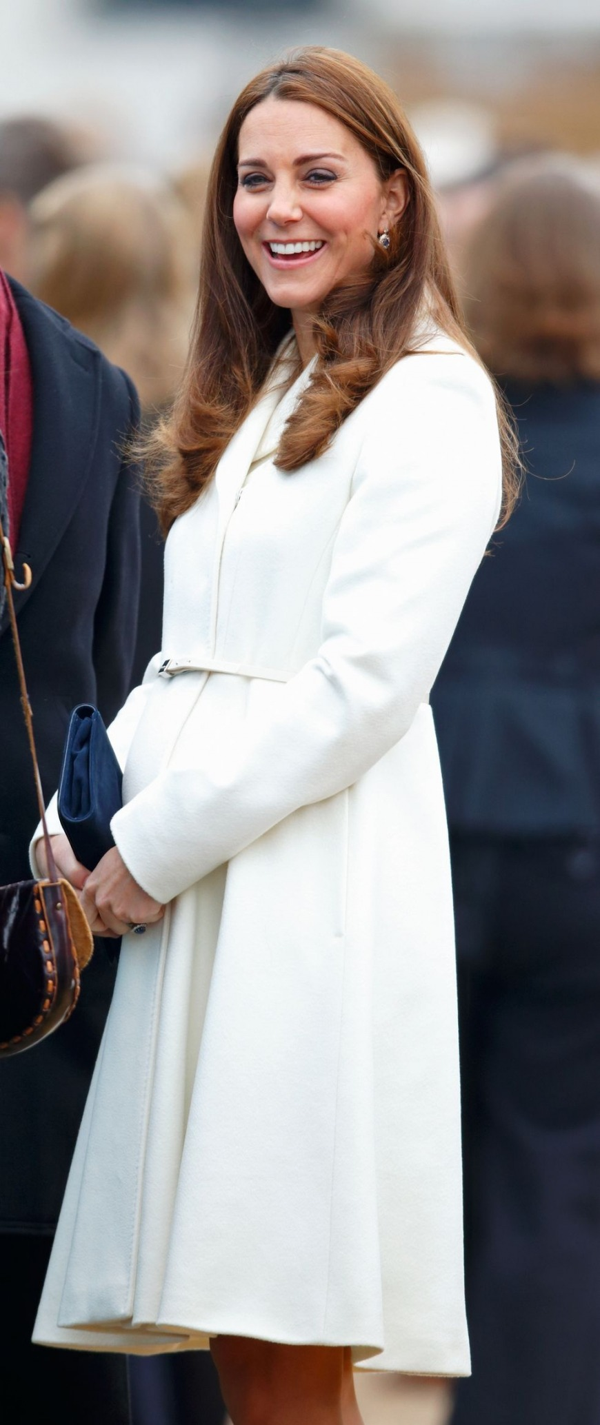You can never go wrong with white. The Duchess paired this white coat with a blue bag for a visit to Portsmouth