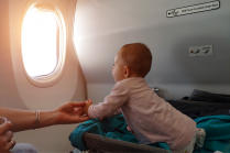 Baby sneaks into Emirates Airline Business Class flight